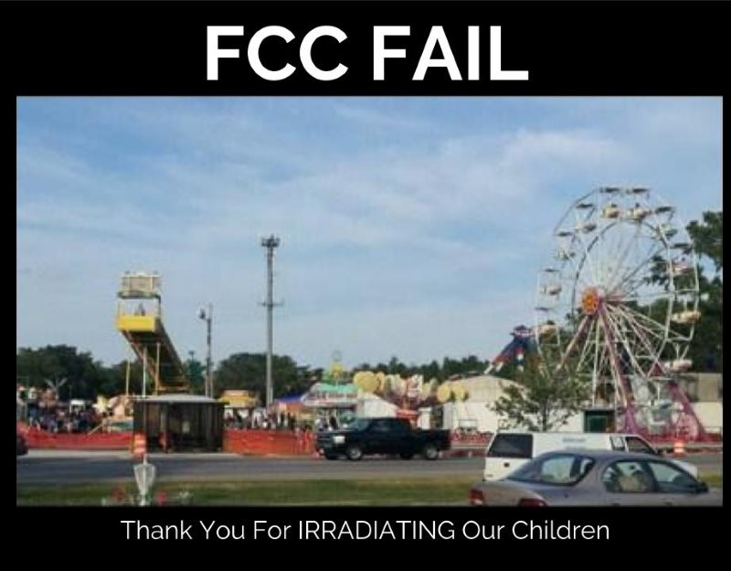 Picture of a cell tower looming over a carnival for children. The caption: FCC Fail. Thank you for irradiating our children!